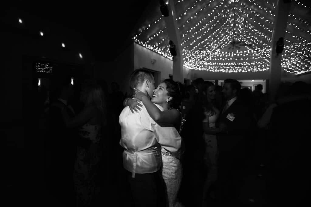 bride and groom embrace during first dance