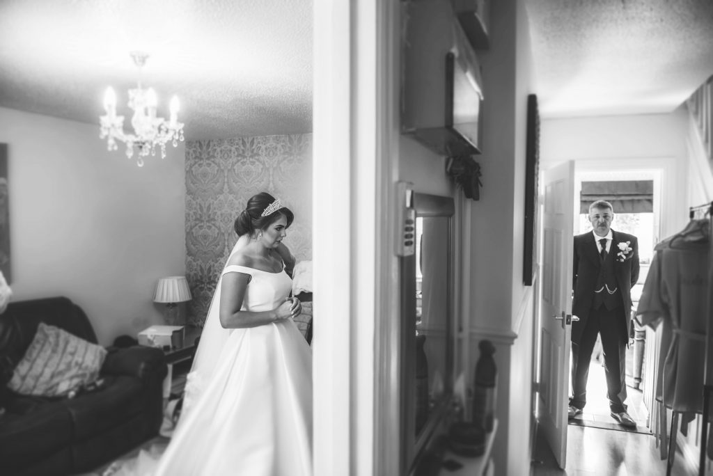 bride and father stood in room