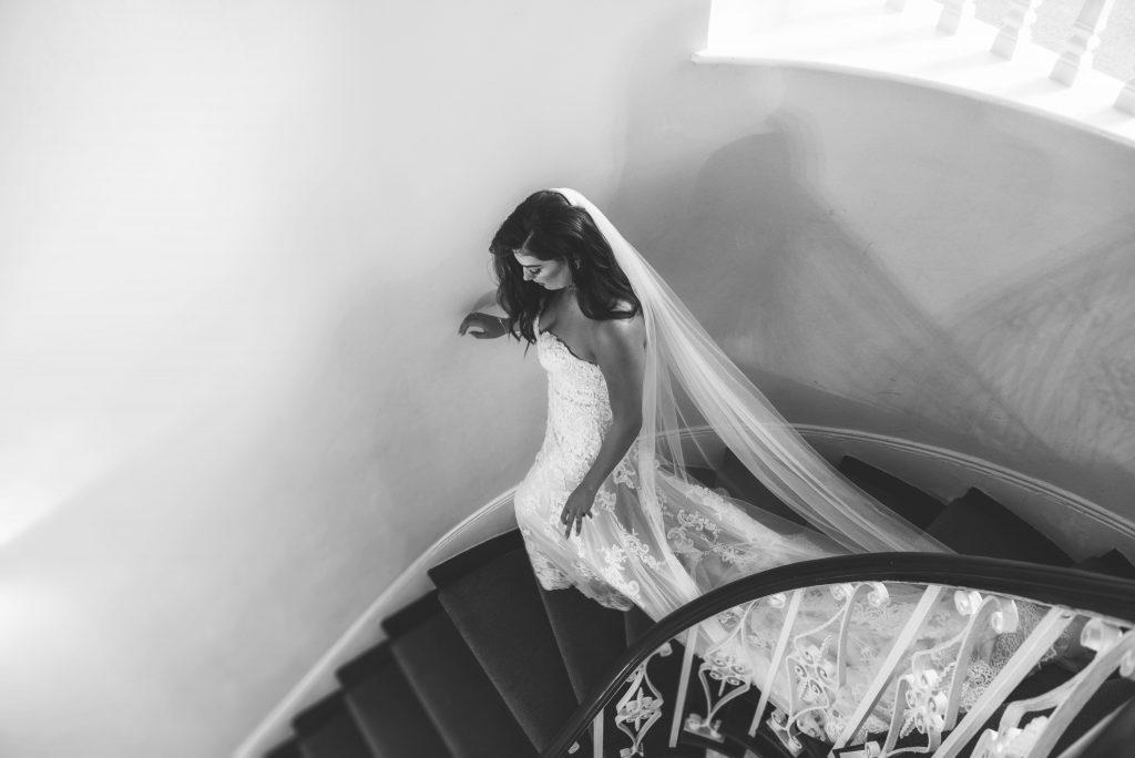 bride walking down spiral stair case