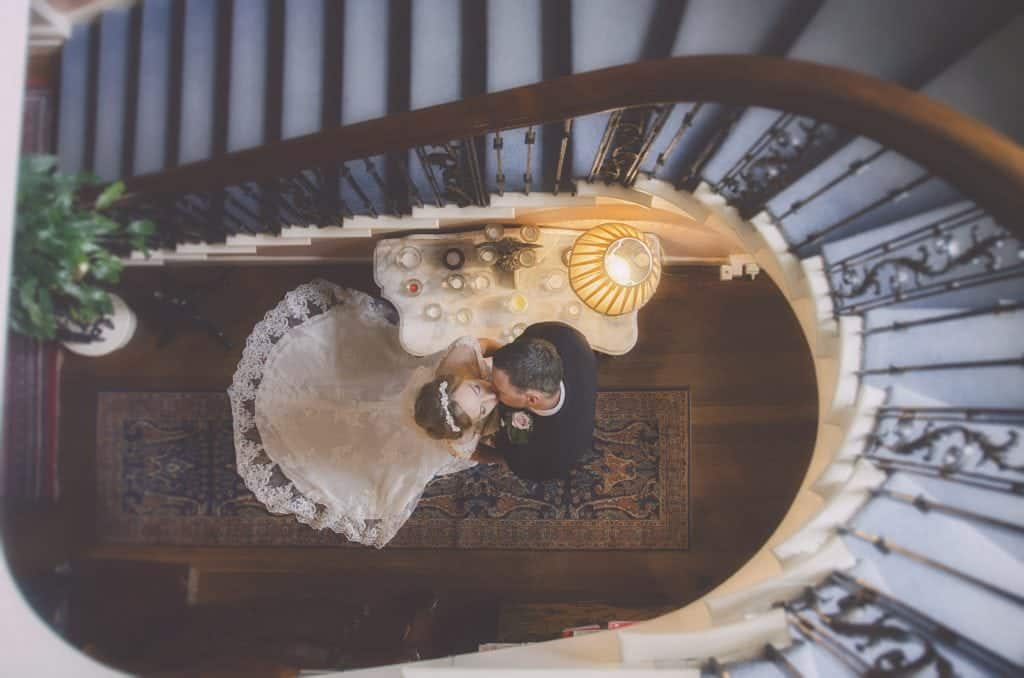 wedding photographers near me Bride & Groom Stood in a stair well kissing