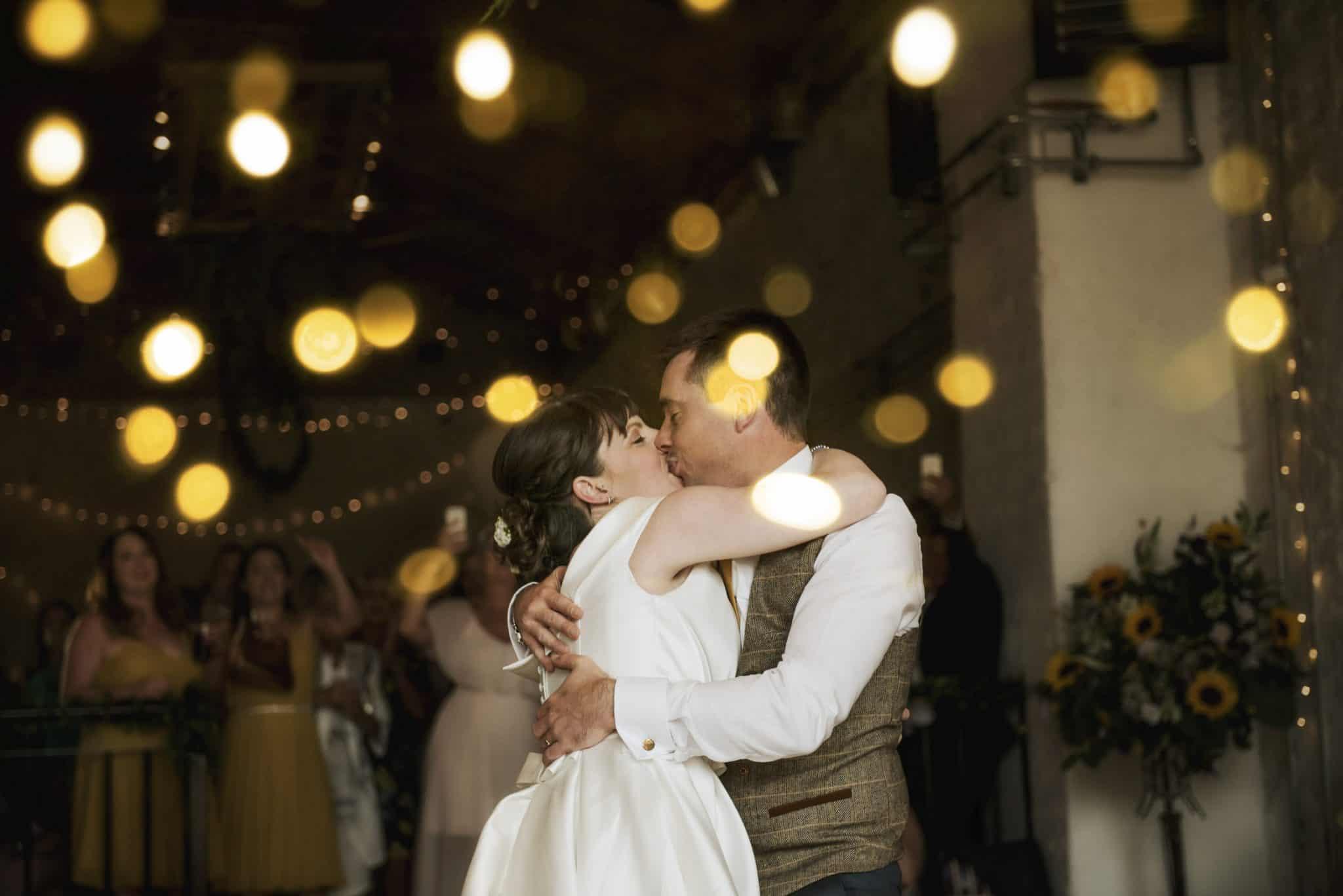 Bride & Groom hug and kiss on dance floor