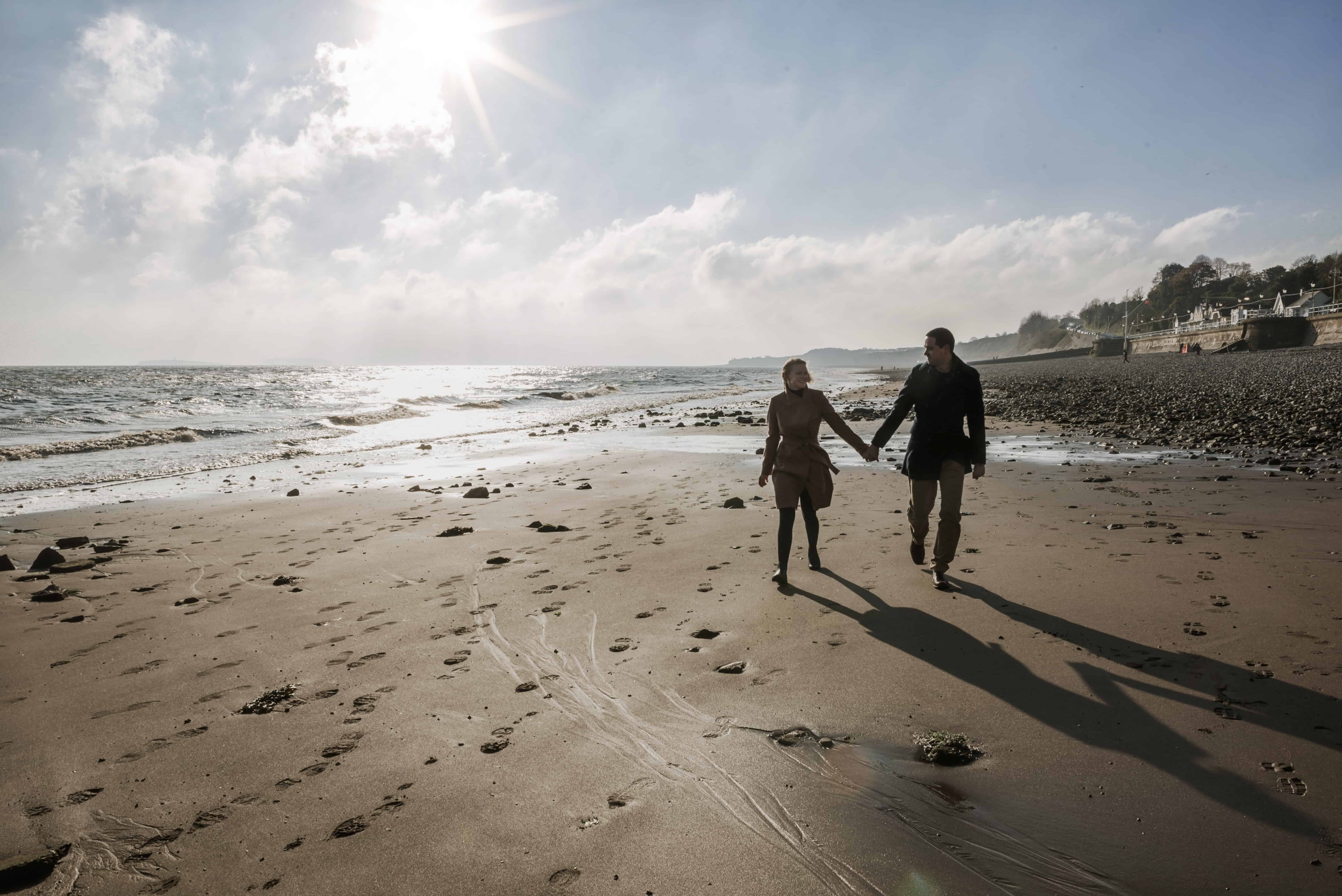 Couple walking on a sandy beach